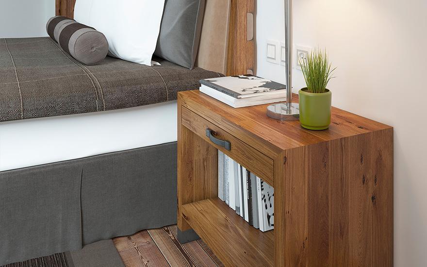 Brązowa szafka stojąca przy łóżku